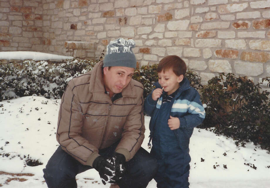 Vietnam veteran Jerry Riddell stands in the snow with his 2-year-old son, Brad, in Austin in 1984, more than a decade before he was diagnosed with glioblastoma.