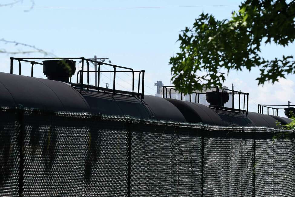 Rail tanker cars are parked behind the Ezra Prentice Homes on Wednesday, July 26, 2017, on South Pearl Street in Albany, N.Y. The New York State Department of Environmental Conservation has built an air monitoring station at the site to evaluate air quality. (Will Waldron/Times Union)