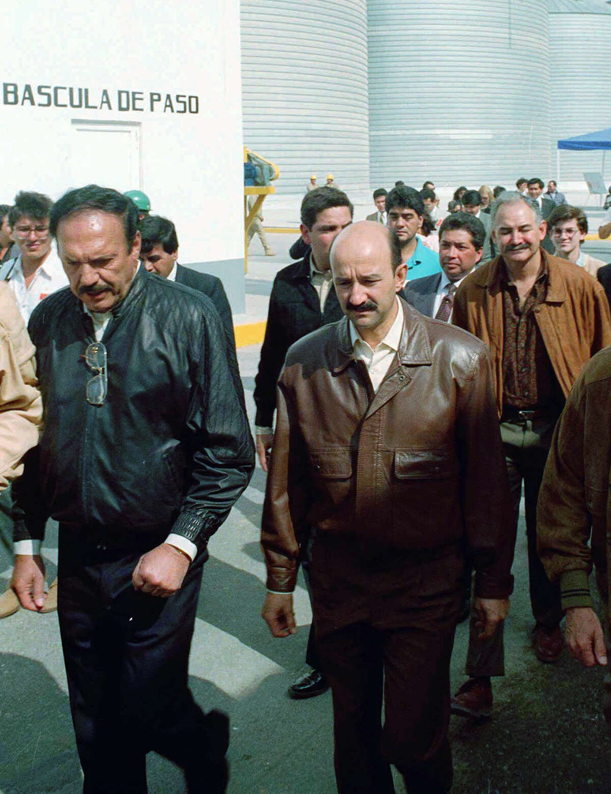 FILE - Roberto Gonzalez Barrera, left, owner of Maseca (now Gruma), and the Mexican President Carlos Salinas de Gortari, walk together in this December 1991 file photo taken at the Maseca Corn Flour factory in Teotihuacan, outside Mexico City. Following the men at right is Raul Salinas de Gortari now in jail on charges of masterminding the murder of a top politician and illicit enrichment. The Mexican government on Friday, July 5, 1996, disputed a New York Times report that a congressional commission implicated Salinas' successor, President Ernesto Zedillo, in a questionable government payment to Barrera's company in 1989. (AP Photo/MIC Photo Press)