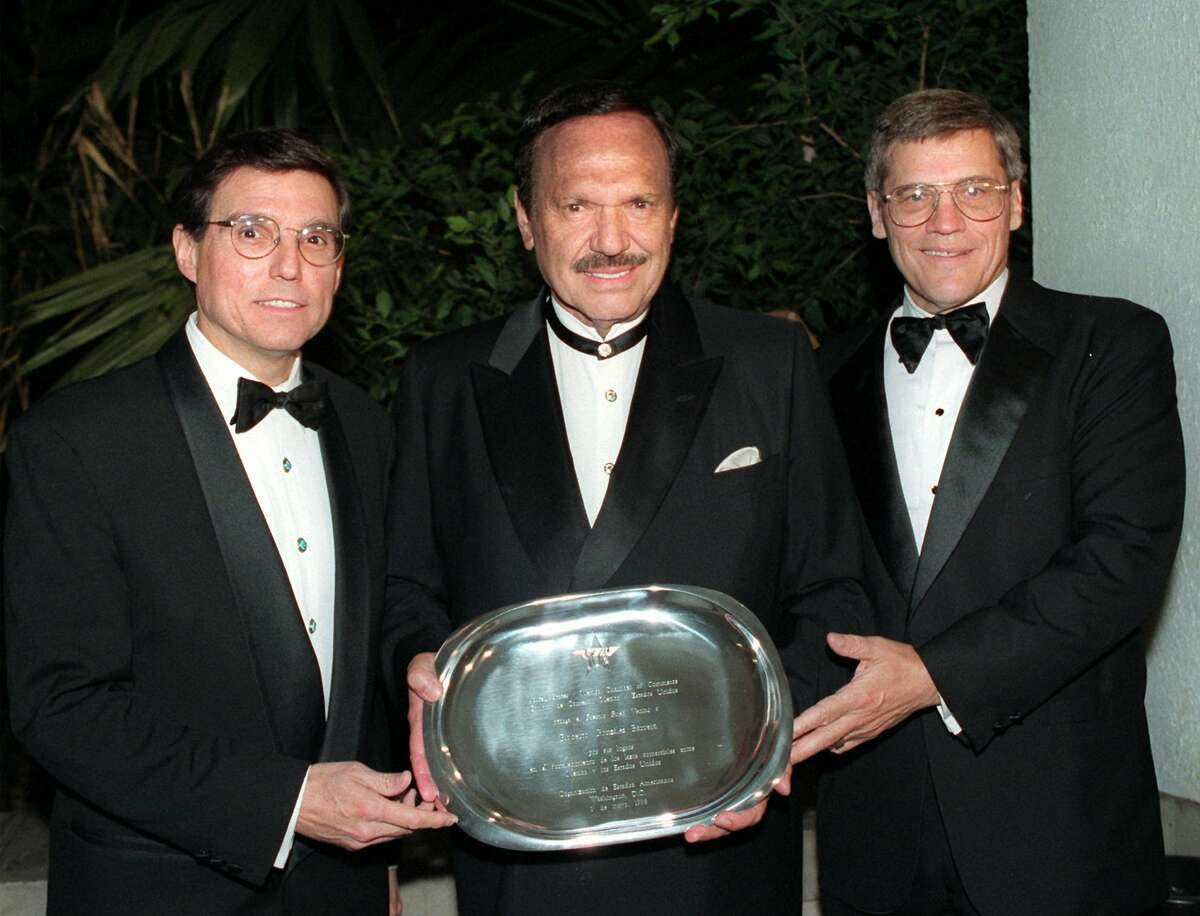 FILE - Grupo Maseca (now Gruma) President Roberto Gonzalez Barrera, center, holds his Good Neighbor Award, flanked by outgoing Energy Secretary Federico Pena, left, and former Chamber of Commerce President Duane Zobrist, during the U.S.-Mexico Chamber of Commerce dinner in Washington Friday May 1, 1998.