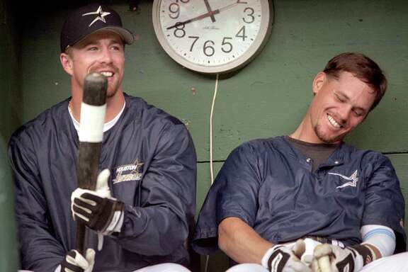 04/01/1996 - Craig Biggio and Jeff Bagwell laugh in the dugout before the Astros home opener against the Los Angeles Dodgers, April 1, 1996.