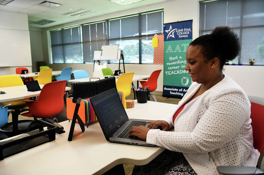 Latoya Lewis, director of the Associates of Arts in Teaching program at Lone Star College Tomball (LSC-Tomball) and a teaching fellow and instructor in the TEaCH lab, works in a mock classroom created at the campus to help new teachers learn with new technology. Photo: Jerry Baker, Freelance / Freelance