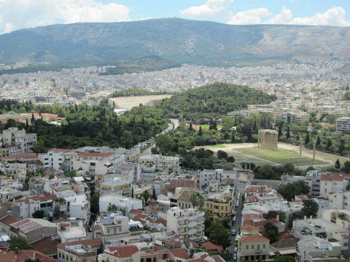 A view from the Acropolis shows the Temple of Zeus (on the right) and the 1896 Olympic stadium (center) in Athens.
