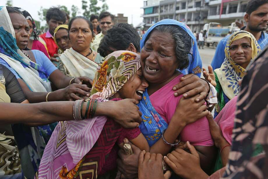 Indian flood victims break down after they met at a camp for the displaced in Thara in Banaskantha district, Gujarat, India, Wednesday, July 26, 2017. At least 29 people have died in the state of Gujarat amid torrential rains. This week's deaths have taken the toll the state to 83 since the start of the monsoon season which runs from June through September. (AP Photo/Ajit Solanki) Photo: Ajit Solanki, Associated Press