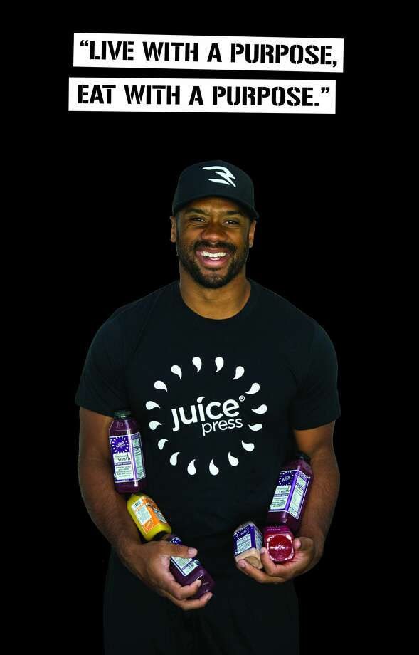 Seahawks quarterback Russell Wilson will open a Juice Press store in Seattle's University Village this fall. Photo: Juice Press/West2East Empire