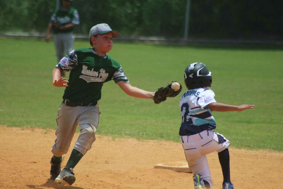 """Elijah Zamaripas appears ready to be an out at second base during a game earlier this month, but his slide into the bag knocked the """"snow cone"""" ball loose. Pasadena's Bronco All-Stars will need a little luck like that in Tampa, starting tomorrow. Photo: Robert Avery"""