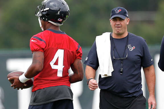 Houston Texans head coach Bill O'Brien walks past \ quarterback Deshaun Watson (4)warms up during the opening practice of training camp at the Greenbrier on Wednesday, July 26, 2017, in White Sulphur Springs, W.Va.