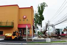 Crews put the finishing touches on the new Popeyes Louisiana Kitchen at 497 Connecticut Ave. in Norwalk, Conn., one of two new chains for the retail stretch along with a Chick-fil-A under construction at 467 Connecticut Ave. With Chick-fil-A's arrival, Pizza Hut will become the largest U.S. restaurant chain not to have a Norwalk location, with the companies ranked eighth and ninth by QSR based on revenue, and Popeyes 20th.