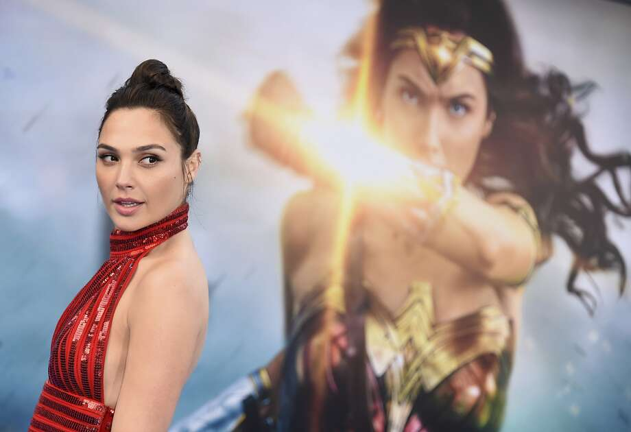 """FILE - In this May 25, 2017 file photo, Gal Gadot arrives at the world premiere of """"Wonder Woman"""" in Los Angeles. Wonder Woman 2"""" is set to storm theaters on December 13, 2019. Warner Bros. announced the date late Tuesday, July 25. """"Wonder Woman"""" star Gadot is set to reprise her role as Diana of Themyscira, but a director has yet to be set. Patty Jenkins is still in negotiations for the job. (Photo by Jordan Strauss/Invision/AP, File) Photo: Jordan Strauss, Associated Press"""