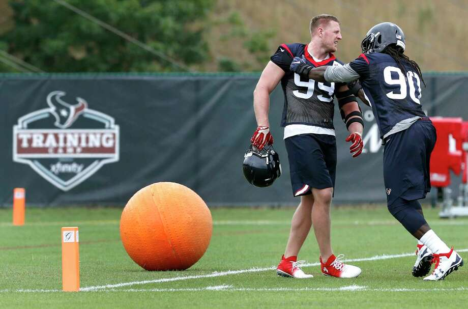 Houston Texans defensive ends J.J. Watt (99) and  Jadeveon Clowney (90) work on a drill together during Texans training camp at the Greenbrier on Wednesday, July 26, 2017, in White Sulphur Springs, W.Va. Photo: Brett Coomer, Houston Chronicle / © 2017 Houston Chronicle}