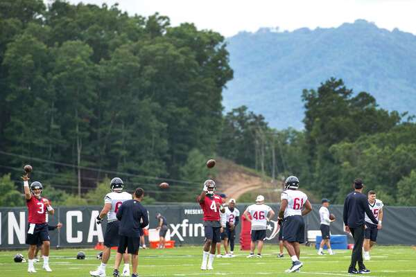 Houston Texans quarterbacks Tom Savage (3) and Deshaun Watson (4) throw passes in the shadow of the mountains during training camp at the Greenbrier on Wednesday, July 26, 2017, in White Sulphur Springs, W.Va.