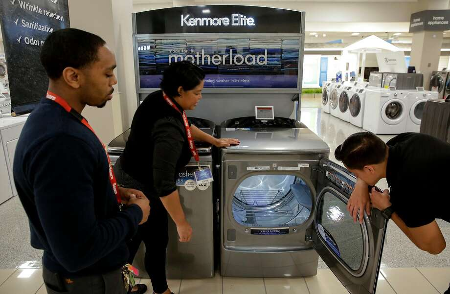 Sales associates Zachary Washington (left), Sheryl Morello and Diego Carbajal work in the appliance depart ment at the Sears store at Tanforan in San Bruno. Sears will sell its Kenmore appliances through Amazon. Photo: Michael Macor, The Chronicle