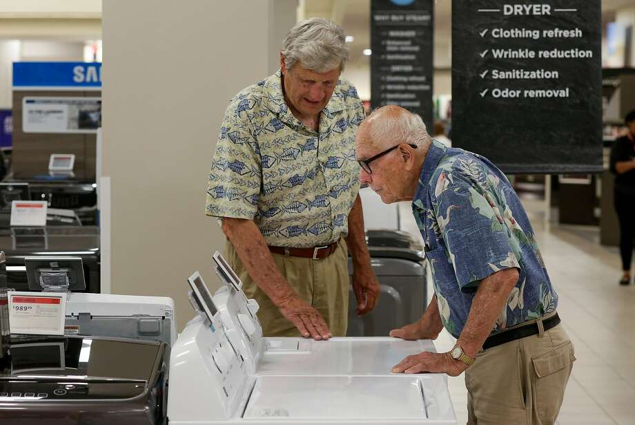 Carl Bianchini (left) of San Carlos shops for a washer Tuesday with Aldo Dossola of Menlo Park at the Sears store at Tanforan in San Bruno. Sears has a new partnership with Amazon. Photo: Michael Macor, The Chronicle