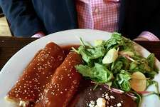 Chicken enchiladas con mole rojo ($20) had a complex sauce but were tepid on arrival.