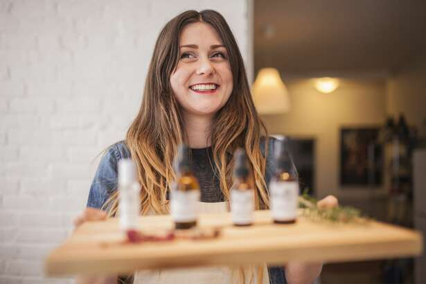Female business owner with essential oil products