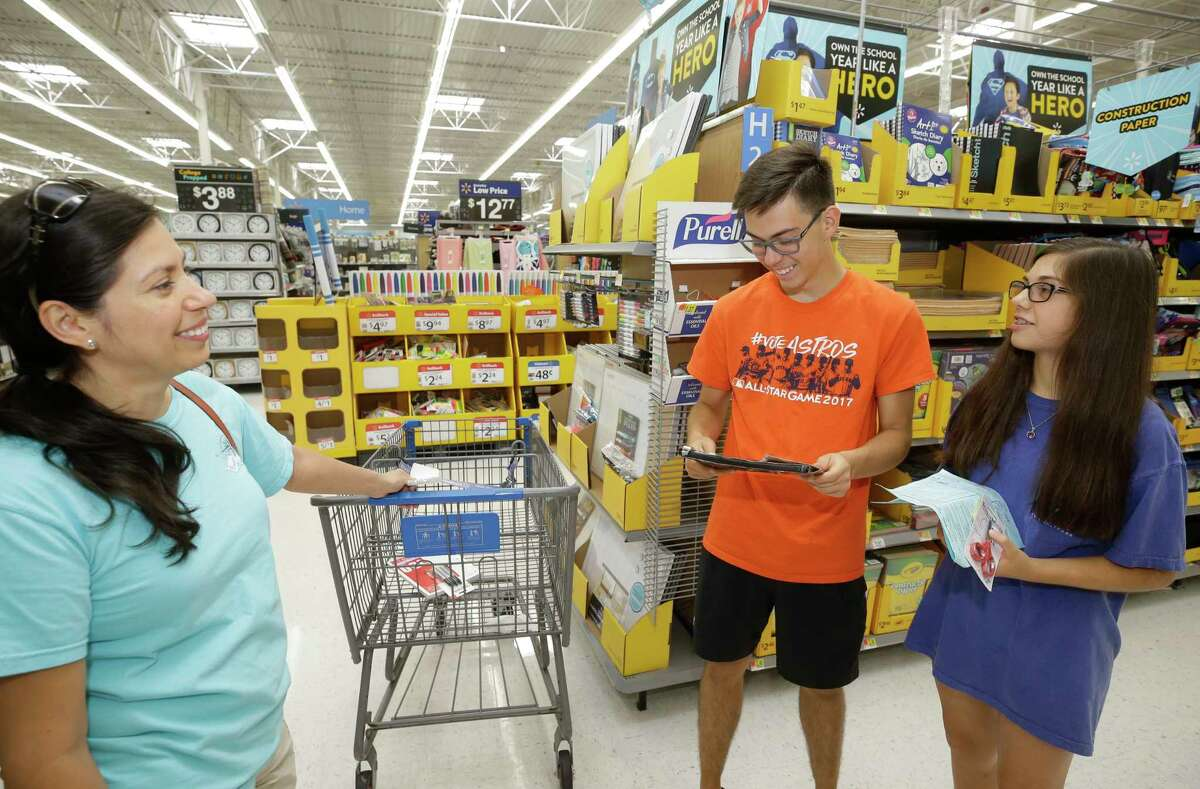 Alma Arroyave, of Cypress, shops with her son Avery, 19, a freshman at UT-Austin, and her daughter Audrey, 13, an eighth-grader, for school supplies at the Walmart in Tomball.