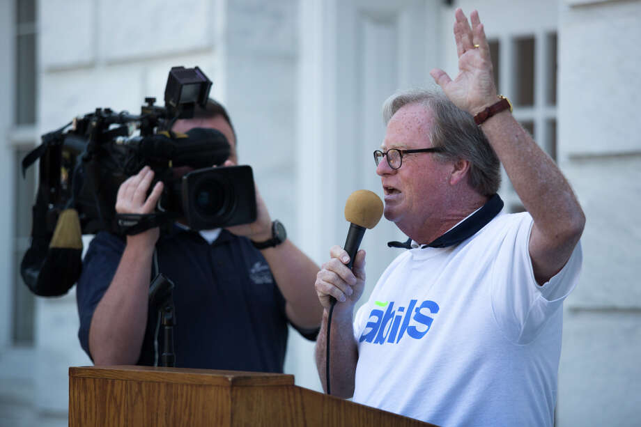 Abilis President and CEO Dennis Perry speaks during the Alibis rally outside Greenwich Town Hall on Wednesday, July 26, 2017. Abils, a human service agency dealing with the developmentally disabled, held a rally protesting the cuts being forced upon it due to the lack of a state budget. Photo: Chris Palermo, For Hearst Connecticut Media / Greenwich Time Freelance