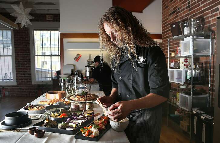 CEO /founder Payton Curry of Flourish makes heirloom tomato salad on Thursday, July 20, 2017, in San Francisco, Calif.