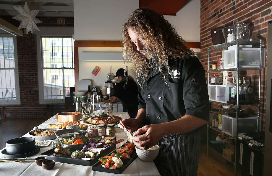 Chef Payton Curry, founder of medicated-edibles company Flourish, makes an heirloom tomato salad. Photo: Liz Hafalia, The Chronicle