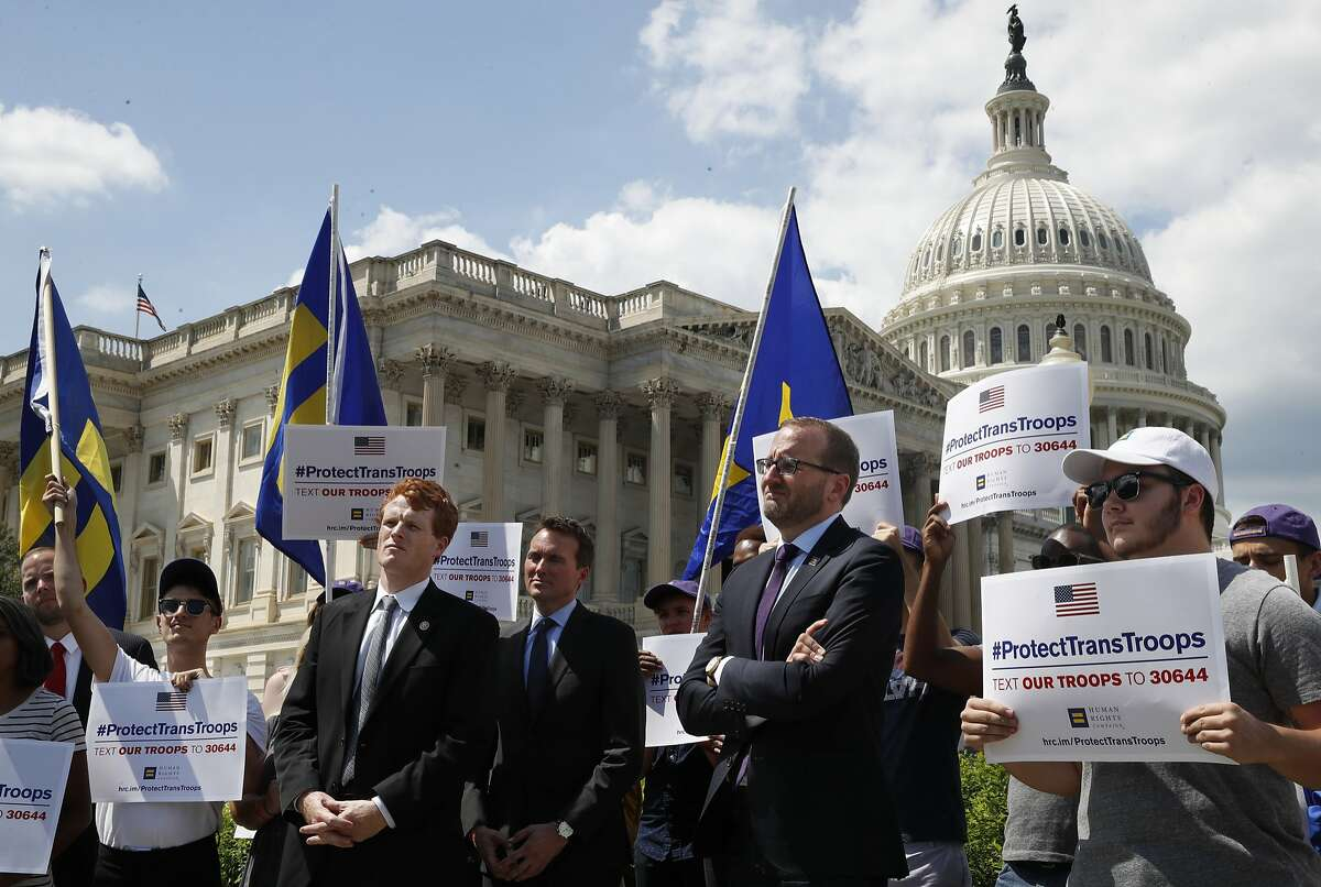 """Rep. Joe Kennedy, D-Mass., third from right, listens during an event in support of transgender members of the military, Wednesday, July 26, 2017, on Capitol Hill in Washington, after President Donald Trump said he wants transgender people barred from serving in the U.S. military """"in any capacity,"""" citing """"tremendous medical costs and disruption."""" (AP Photo/Jacquelyn Martin)"""