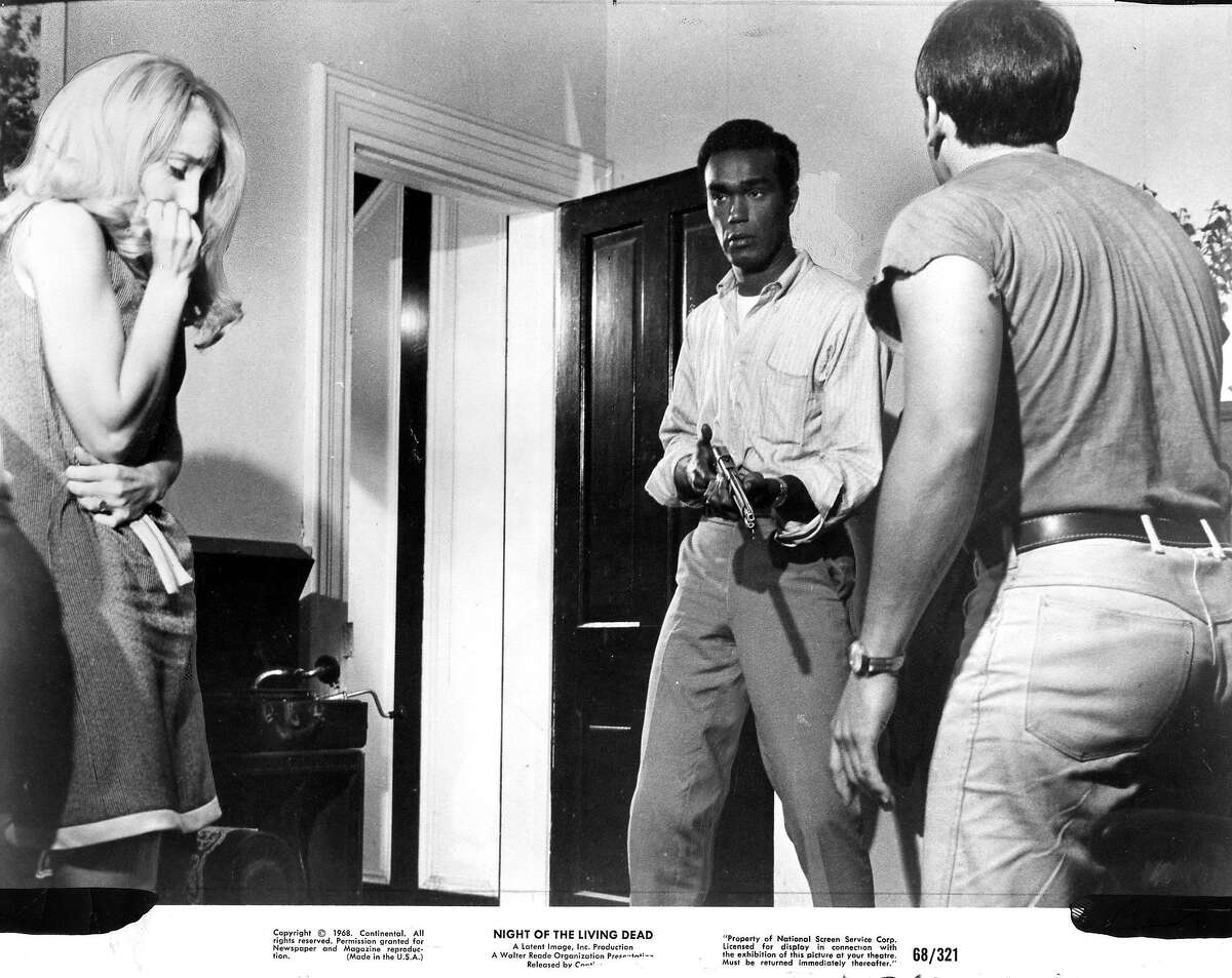 """Duane Jones (middle) in a scene from """"Night of the Living Dead,"""" by George A. Romero Handout photo , 1968 Photo ran 12/30/173, p. 14, Sunday Datebook"""