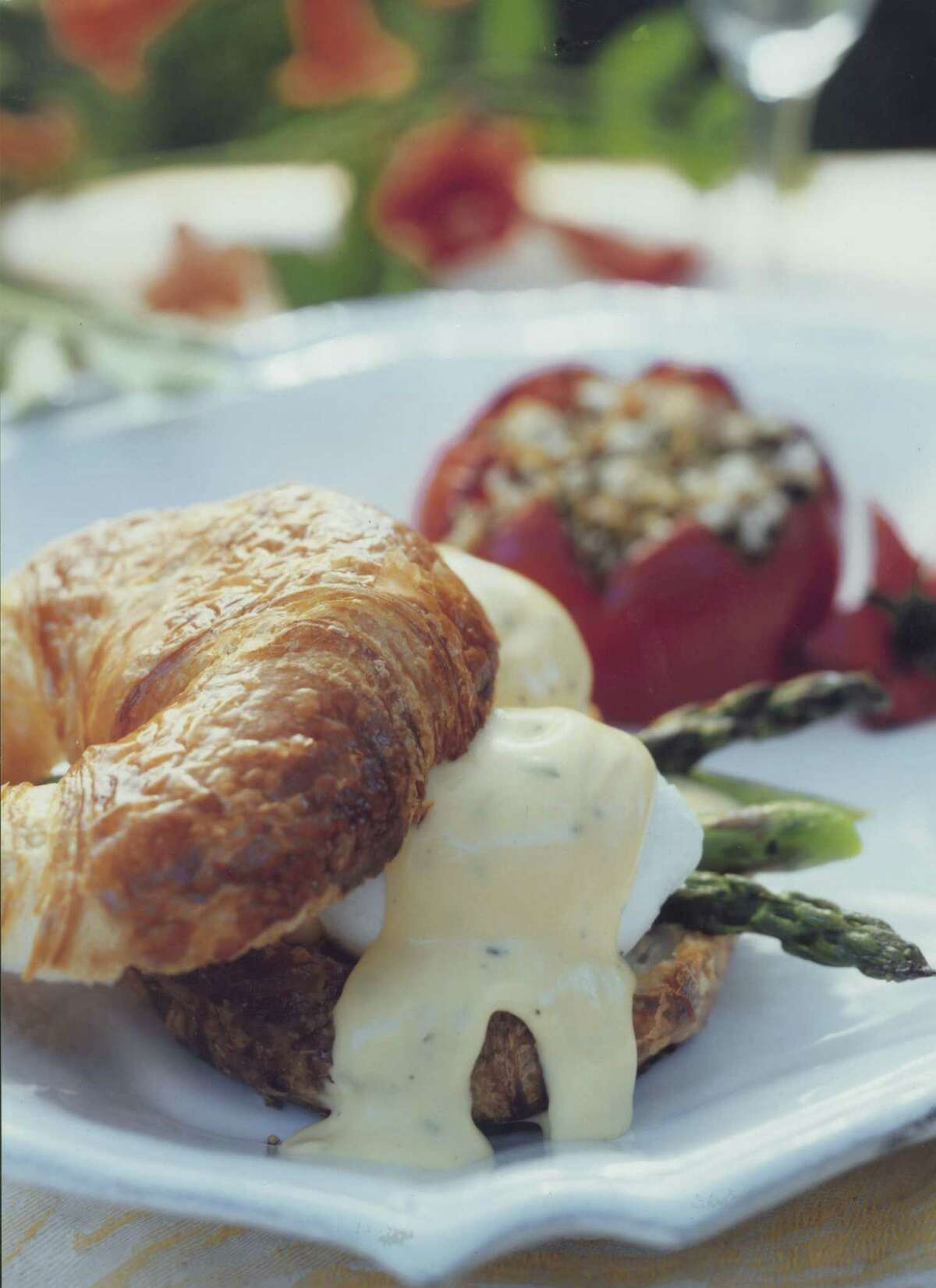 Parisian Eggs Benedict is a La Madeleine favorite, made from poached eggs served on a croissant and topped with ham, bacon and hollandaise sauce