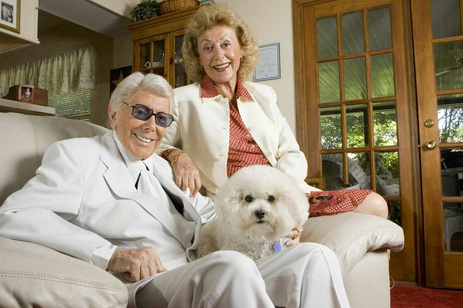 ABC 13 reporter Marvin Zindler (cq)  poses for a portrait with his wife Niki Zindler (cq) and their dog Magic Thursday, May 11, 2006, in Houston. Photo: BRETT COOMER/HOUSTON CHRONICLE