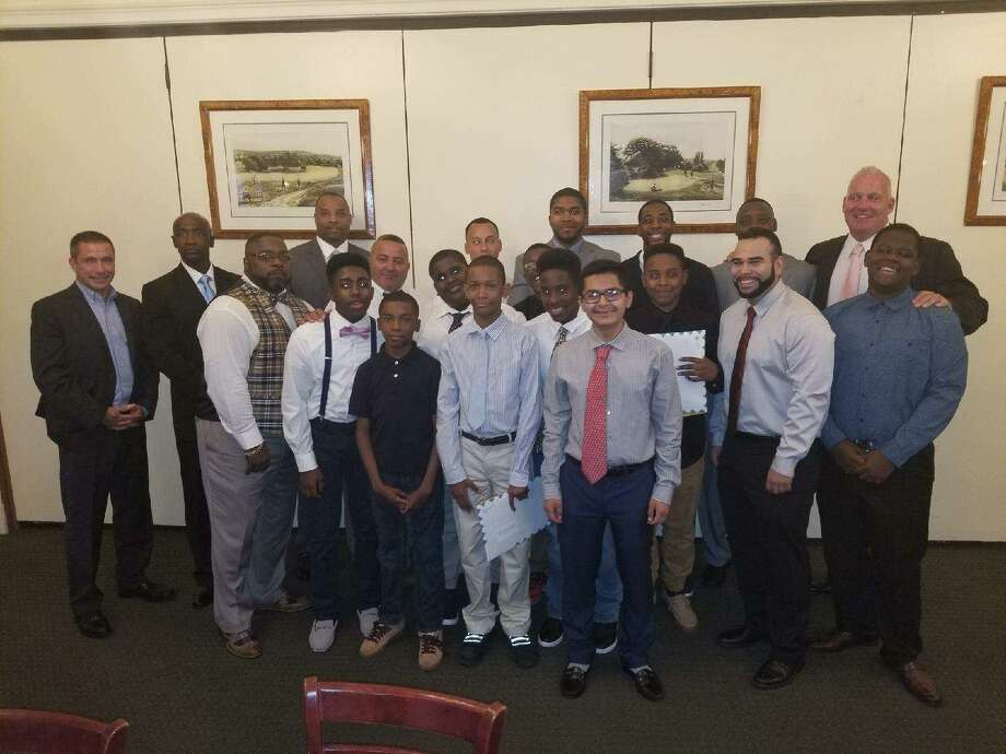 Boys Leadership Group graduation night. First row: Javan Green, Emmanuel Reddic, and Kevin Lopez Second row, Tyree Harris, Anthony Desiree, Dewayne Williams,Tyrie Nelson,Chris Arenas and Geverson Fabre and third row officers Kenny Boyd, James Stackpole, Marquis Clark and Rahiem Farrow of Domus. Photo: Stamford Police / Contributed