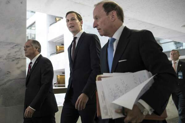 White House senior adviser Jared Kushner, center, and his attorney Abbe Lowell, right, depart Capitol Hill Monday after a closed-door interview with Senate Intelligence Committee investigators looking into Russia's election meddling and possible ties to the Trump Administration. Recent presidential actions call into question whether the president believes he's above the law.
