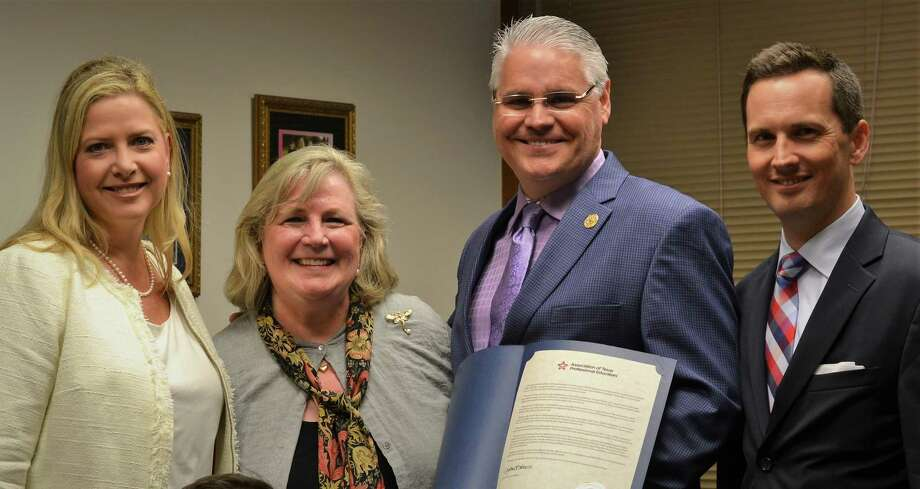 Representatives of the Association of Texas Professional Educators present State Rep. Dan Huberty with a resolution. Pictured, from left to right, are Jennifer Canaday, ATPE government relations director; Gayle Sampley, ATPE member; Huberty; Mark Wiggins, ATPE lobbyist. Photo: Courtesy