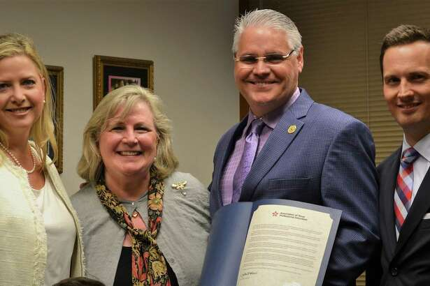Representatives of the Association of Texas Professional Educators present State Rep. Dan Huberty with a resolution. Pictured, from left to right, are Jennifer Canaday, ATPE government relations director; Gayle Sampley, ATPE member; Huberty; Mark Wiggins, ATPE lobbyist.