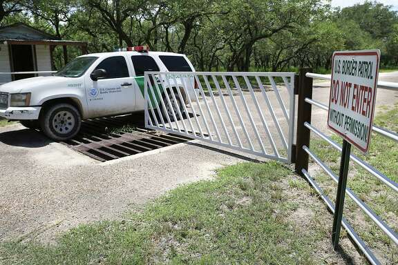 A Border Patrol unit from U.S. Customs and Border Protection leaves a private ranch south of Falfurrias earlier this summer. Agents work closely with ranch owners while monitoring immigrant crossings.