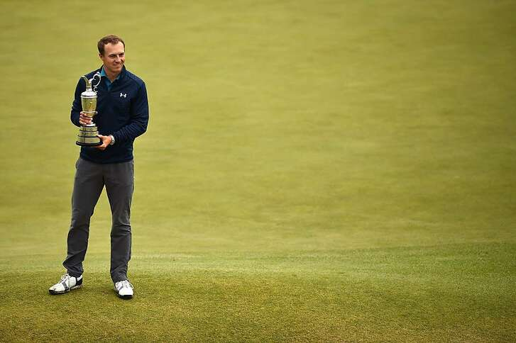 SOUTHPORT, ENGLAND - JULY 23:  Jordan Spieth of the United States celebrates victory as he poses with the Claret Jug on the 18th green during the final round of the 146th Open Championship at Royal Birkdale on July 23, 2017 in Southport, England.  (Photo by Dan Mullan/Getty Images)