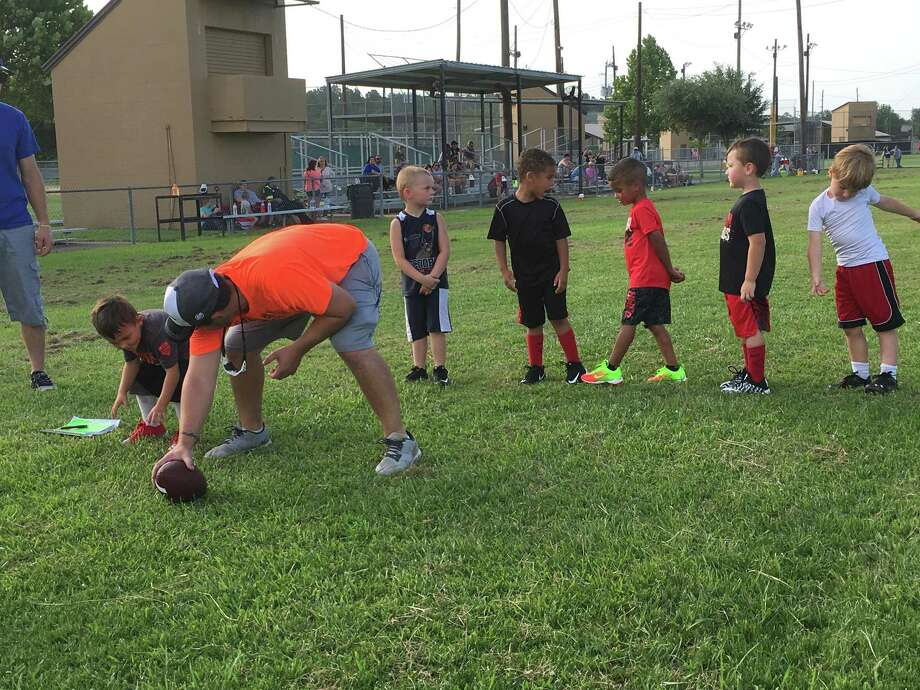 The Mighty Mights, the four-year-old division of the Huffman Youth Athletic Association football league, take turns working on an off-the-ball drill during tryouts at the football field at I.T. May Park on July 25 Photo: Elliott Lapin