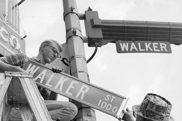 June 22, 1967: David Dominy, left, and Billy Bullock make the street sign change at Fannin and Walker Streets in the business district. The letters in the new signs are six inches high, compared with 4-inch high lettering on the old ones.