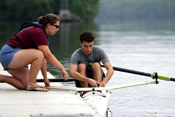 Rowing instructor Ashley Clary, left, gives guidance to Evan Schaffer during an Albany Rowing Center junior summer camp at the Corning Preserve boat launch on Wednesday, July 26, 2017, in Albany, N.Y. The four-day sessions for boy and girls who have finished 7th grade is $200, and runs through mid-August.  www.albanyrowingcenter.org . (Will Waldron/Times Union)