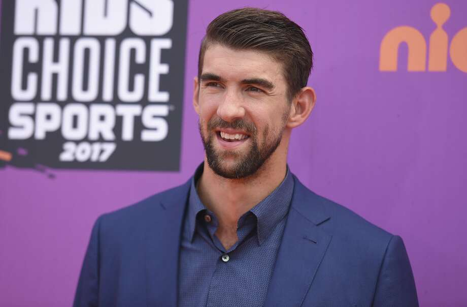 "FILE - In this July 13, 2017 file photo, retired Olympic swimmer Michael Phelps arrives at the Kids' Choice Sports Awards at UCLA's Pauley Pavilion in Los Angeles. Phelps lost to a shark in the Discovery Channel�s Shark Week special �Phelps vs. Shark: Great Gold vs. Great White,"" which aired on July 23, 2017. It was billed as a race between Phelps and the predator but much to the disappointment of some Twitter users, Phelps didn�t actually swim in the water next to the shark.(Photo by Richard Shotwell/Invision/AP, File) Photo: Richard Shotwell, Associated Press"