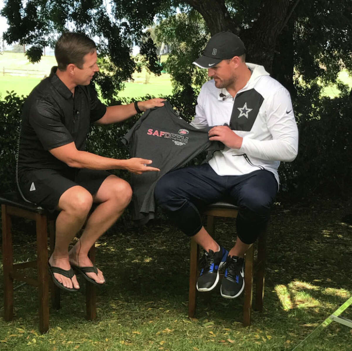 ESPN SA presents Dallas Cowboys' tight end, Jason Witten, with tribute shirt for fallen firefighter, Scott Deem.