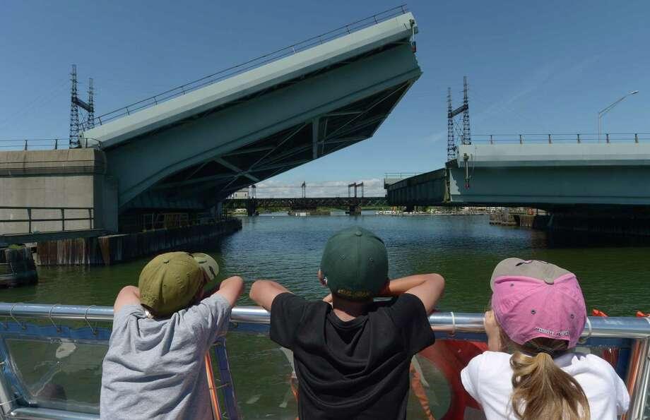 Children aboard the Sheffield Island Ferry watch as the Stroffolino Bridge goes up on the Norwalk River, Wednesday, July 26, 2017, in Norwalk, Conn. Photo: Erik Trautmann, Hearst Connecticut Media / Norwalk Hour