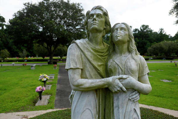 The famous kissing statue of a man and a woman at Forest Lawn Memorial Park. Legend has it that if you shine your headlights on the back of the statue at night, you can see him lean over and kiss her.  Photo taken Friday 7/21/17 Ryan Pelham/The Enterprise