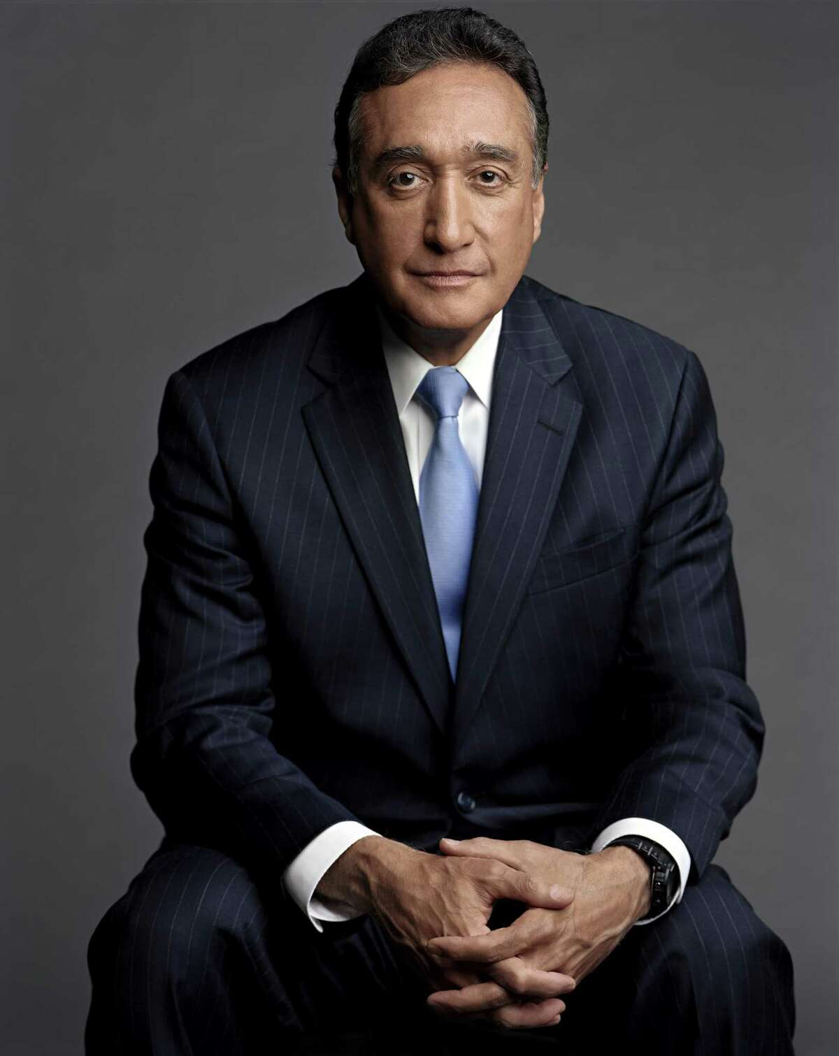 A portrait of former San Antonio Mayor Henry Cisneros, one of the authors of