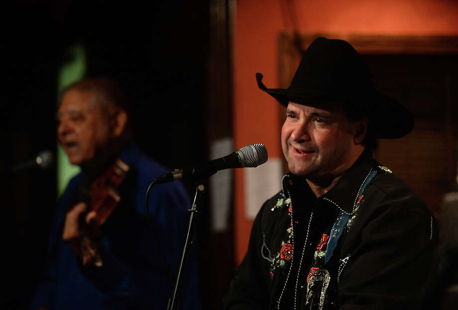 Country crooner Britt Godwin brings a vintage country flare to the stage as lead singer of B. B. & Company, who performed Thursday night at MacKenzie's Pub in Beaumont. Photo taken Thursday, May 21, 2015 Kim Brent/The Enterprise Photo: Kim Brent / Beaumont Enterprise