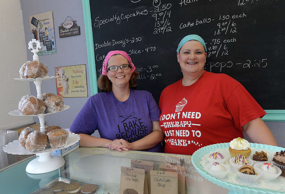 Owner Angie Cook and her baking assistant April Gaspard create a variety of flavorful, decorative confections to satisfy every sweet tooth at Sugar Momma Confections in Groves. Cook says they have been selling out daily on their home-made and colorful cupcakes, cake balls and truffles since opening a month ago. Photo taken Tuesday, July, 18, 2017 Kim Brent/The Enterprise Photo: Kim Brent / BEN