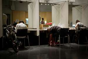 Clients inject themselves at the Insite supervised injection Center in Vancouver, Canada, on May 3, 2011.