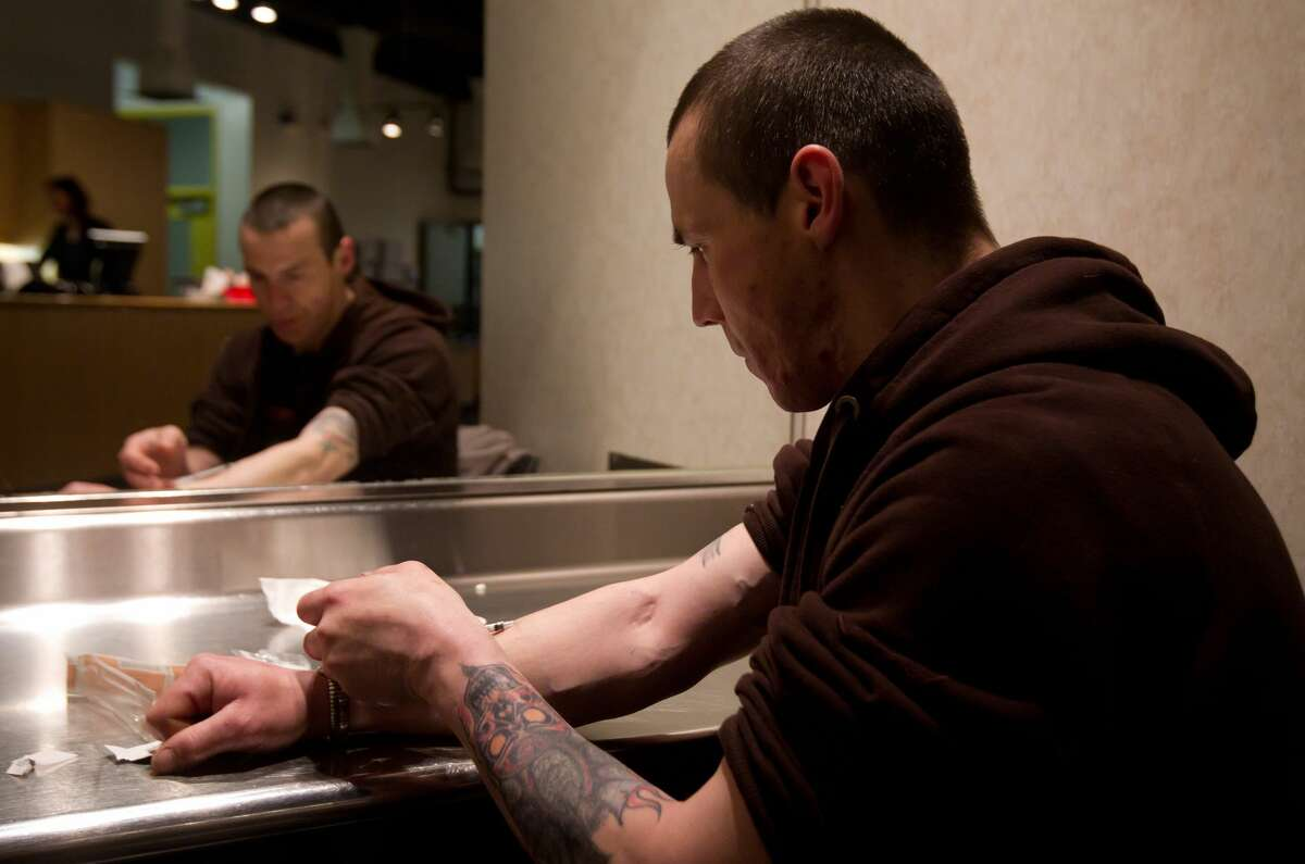 Richard Chenery injects heroin he bought on the street at the Insite safe injection clinic in Vancouver, B.C., on Wednesday May 11, 2011.