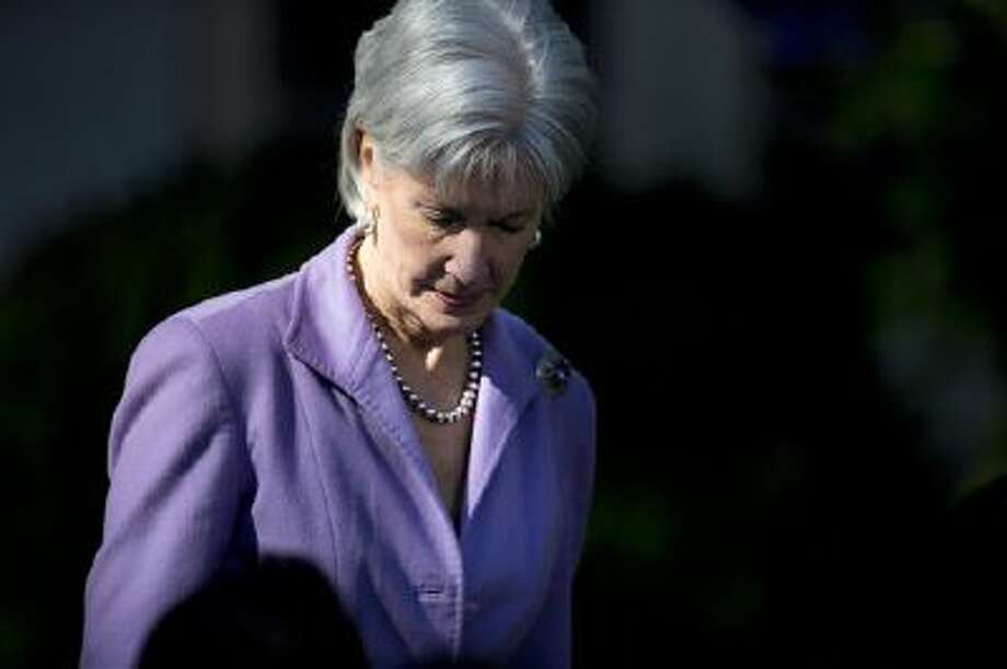 Health and Human Services Secretary Kathleen Sebelius arrives in the Rose Garden of the White House in Washington, Monday, Oct. 21, 2013, for and event with President Barack Obama on the initial rollout of the health care overhaul. Obama acknowledged that the widespread problems with his health care law's rollout are unacceptable, as the administration scrambles to fix the cascade of computer issues. (AP Photo/ Evan Vucci) Photo: AP / AP