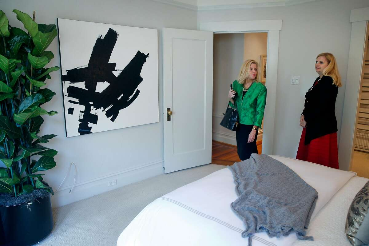 Real estate agent Mary Laughlin Fenton (left) tours a one-bedroom, one-bath Pacific Heights condo on Gough Street listed by Marianne Schier (right) in San Francisco, Calif. on Tuesday, July 25, 2017.