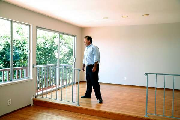 Bob Vernon walks through a single-family home for sale on Berkeley Way in the Diamond Heights neighborhood at an open house for brokers in San Francisco, Calif. on Tuesday, July 25, 2017.