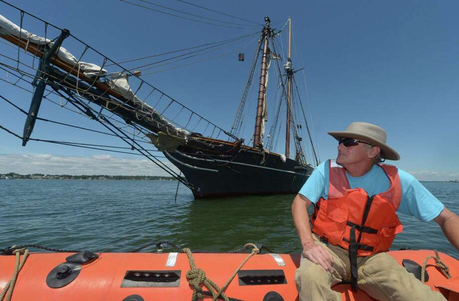 First Mate Engineer Bill DiFrancesco approaches the replica of the Spanish schooner the Amistad that is moored off Sheffield Island Wednesday, July 26, 2017, in Norwalk, Conn. The Amistad was made famous by its slave revolt made by Mende captives in 1839. The African captives seized control of the ship, killing some of the crew and ordering the survivors to sail the ship to Africa. However, the surviving crew steered the Amistad north and it was ultimately captured off the coast of Long Island. The ship and slaves were interned in Connecticut. The Amistad owners claimed the slaves as property, but the U.S. had banned African trade and argued that the captives were legally free. The case, United States v. The Amistad gained international intrigue, and was ultimately decided on in favor of the Mende by the Supreme Court. Photo: Erik Trautmann / Hearst Connecticut Media / Norwalk Hour