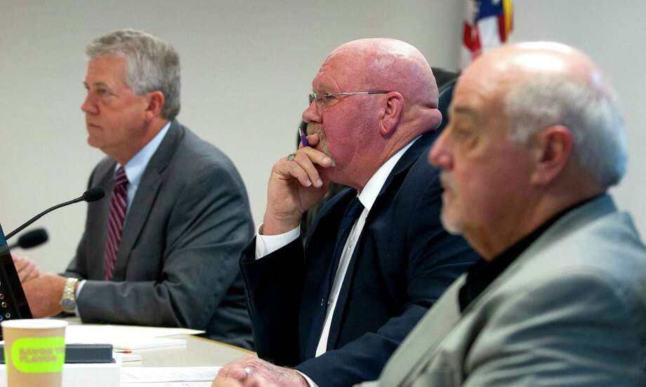 Montgomery County Precinct 2 Commissioner Charlie Riley listens beside County Judge Craig Doyal and Precinct 1 Commissioner Mike Meador during a budget workshop Tuesday. Photo: Jason Fochtman, Staff Photographer / © 2017 Houston Chronicle